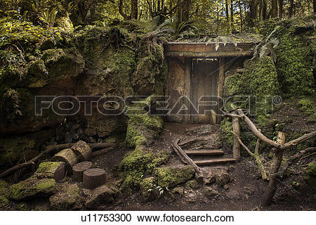 Stock Photography of Entrance to mysterious hidden wood building.