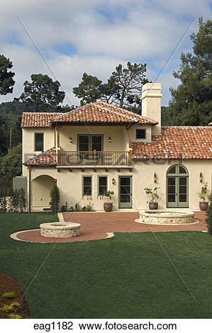 Stock Photo of Exterior of a SPANISH STYLE LUXURY HOME with stucco.