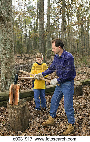 Picture of A father and son work together to chop wood in the.