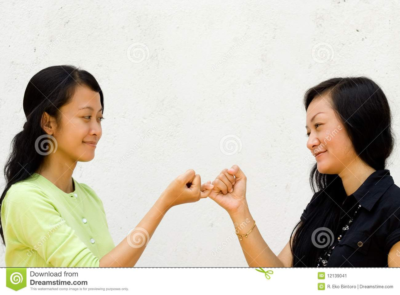 Two Happy Girls Make Peace To Each Other Stock Image.