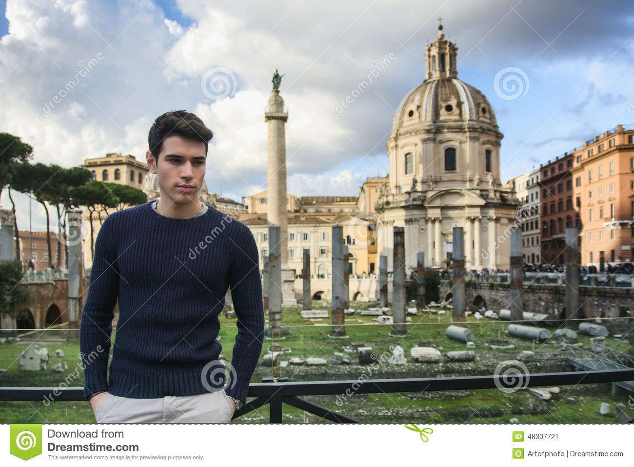 Young Man In Rome Standing In Front Of Foro Traiano And Fori.