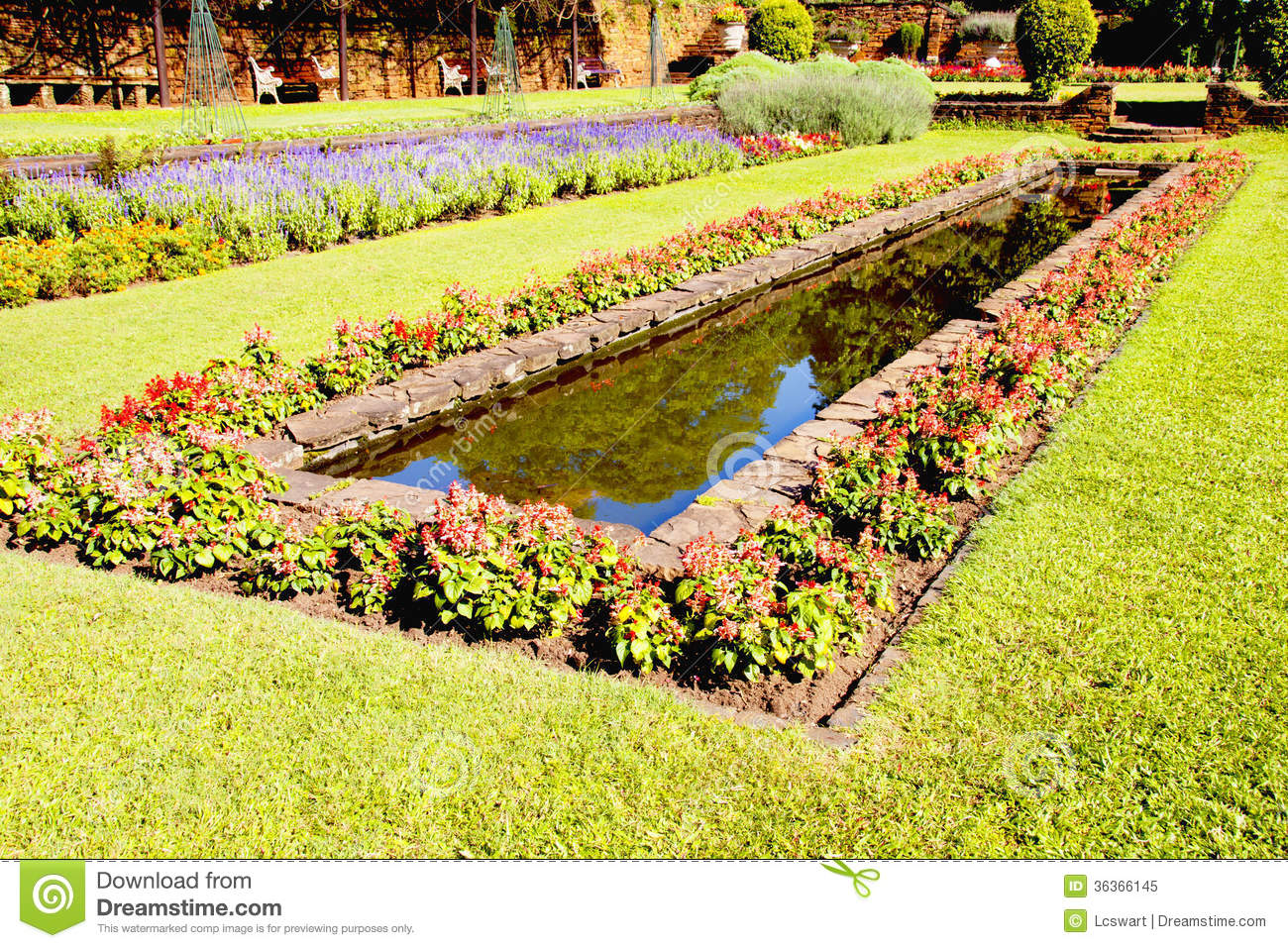 Landscaped Formal Garden With Rectangular Fish Pond Royalty Free.