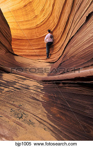 "Stock Image of Hiker in ""The Wave"", a sand and wind eroded rock."