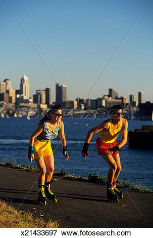 Picture of Pair rollerblading, city and lake backdrop, Gasworks.