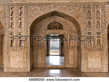 Stock Photograph of Decorated marble wall frames gate and door at.