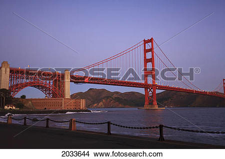 Stock Photo of Golden Gate Bridge From Fort Point Wharf At Sunrise.