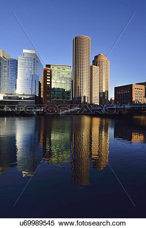 Stock Image of City waterfront reflected in Fort Point Channel.