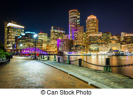 Stock Images of The Boston skyline and Fort Point Channel at night.