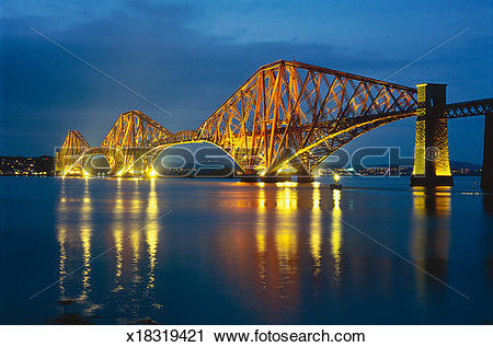 Stock Photography of Forth Rail Bridge illuminating Queensferry.
