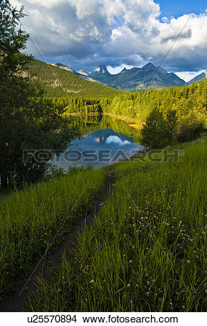 Stock Photo of Fortress Mountain reflected in Wedge Pond.