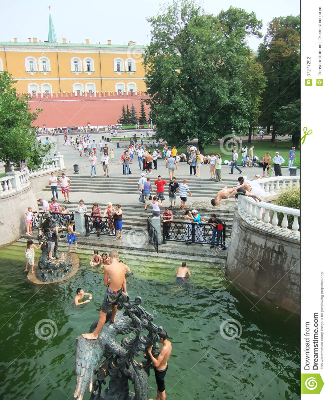 People Swimming In A Fountain, Alexander Gardens, Moscow, Russia.