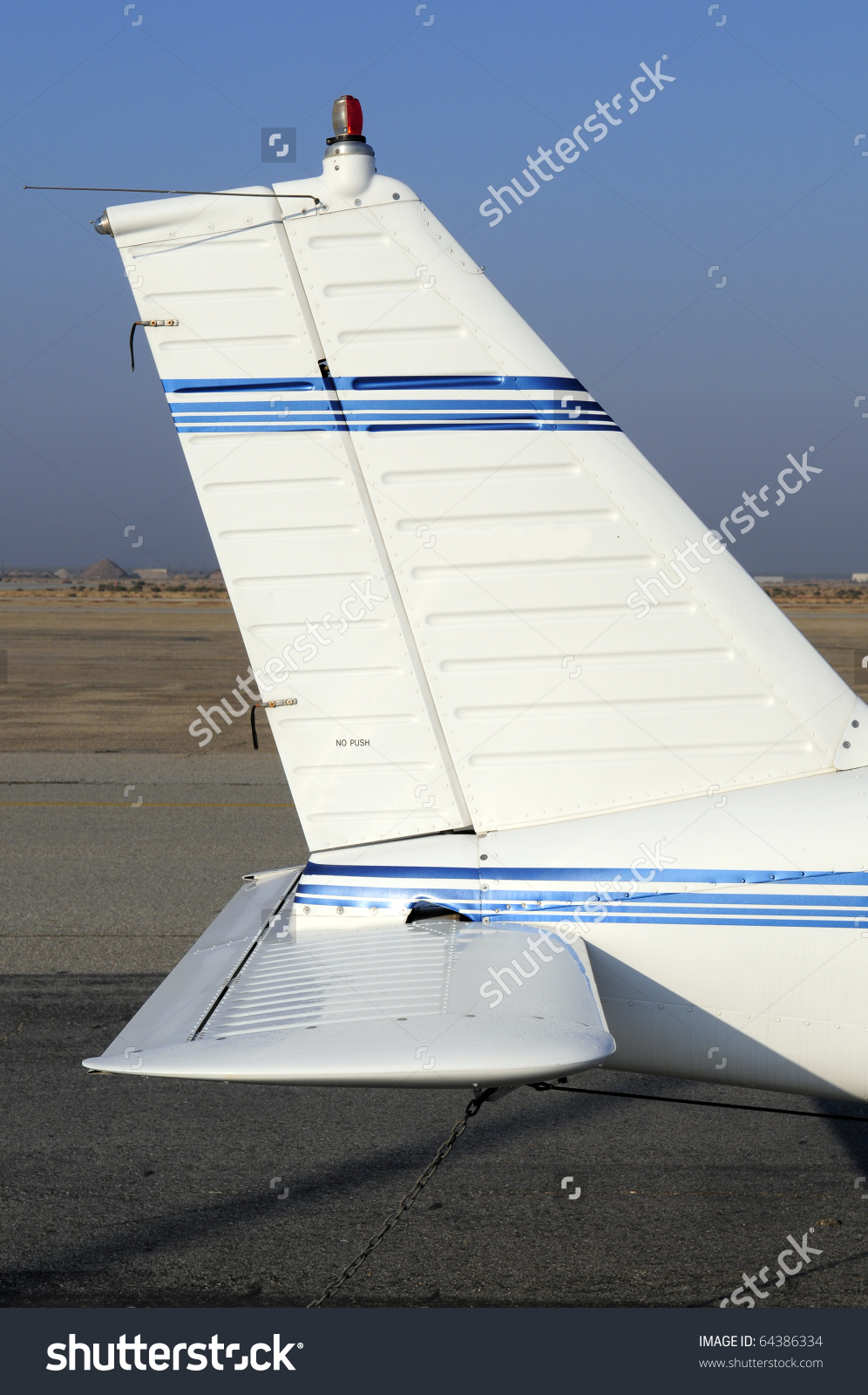 Tail Section Of A Four Place Low Wing Fixed Gear General Aviation.