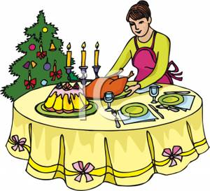 A Woman Setting Christmas Dinner On A Dining Table.