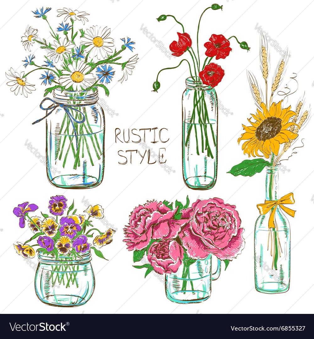 Set of mason jars with flowers.