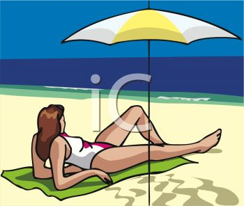 A Woman Laying On The Beach Under An Umbrella.