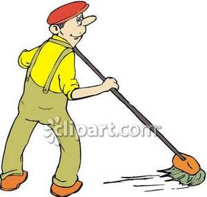 A Janitor Or Custodian Mopping.