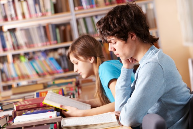 Students reading books and preparing to exam Photo.