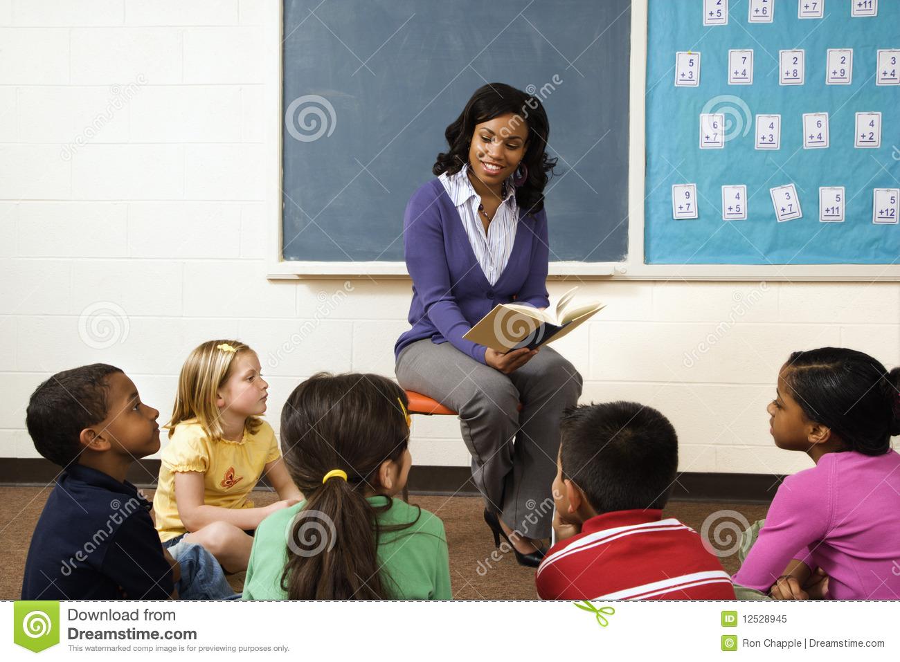 Teacher Reading To Students Royalty Free Stock Photo.