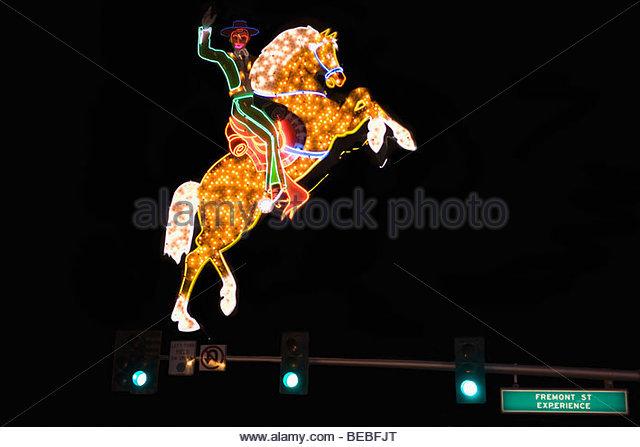 Neon Sign Cowboy Fremont Street Stockfotos und Neon Sign Cowboy.