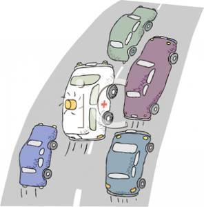 Ambulance In Freeway Traffic.