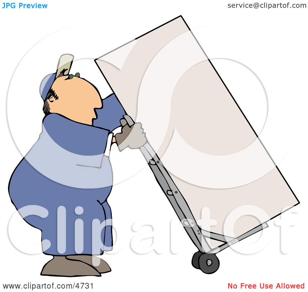 Male Mover Moving a Heavy Refrigerator/Freezer with a Dolly.