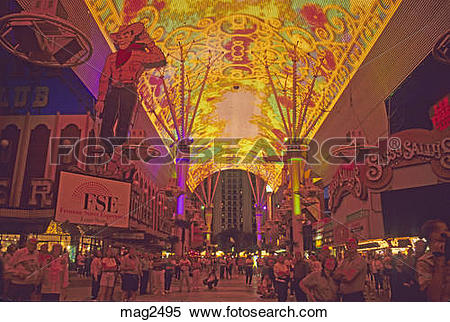 Stock Image of People watching ceiling light show Fremont Street.