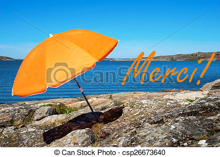 Stock Photo of Swedish Coast With French Merci Means Thank You.