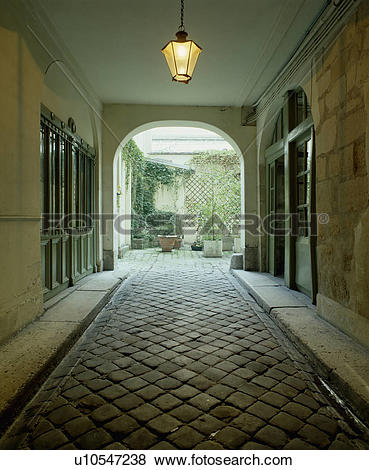 Pictures of Covered paved courtyard and traditional French town.