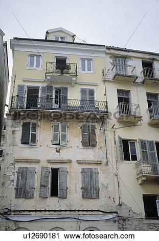 Stock Photography of Dilapidated traditional terraced French town.