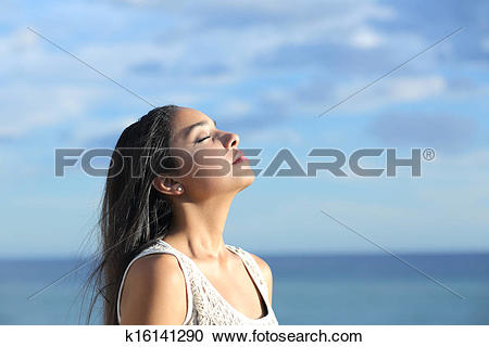 Stock Photography of Beautiful arab woman breathing fresh air in.