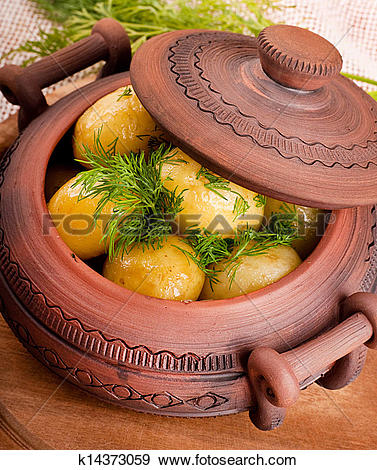 Stock Photograph of Appetizing potato in a pot with fennel of a.