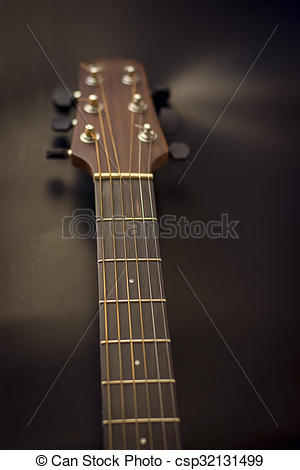 Stock Photographs of Headstock,fret bord,frets,tuners of guitar.