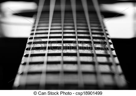 Stock Photographs of Closeup of Guitar Strings and Frets.