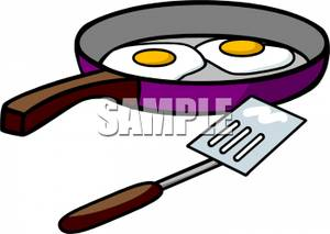 Eggs In a Frying Pan and a Spatula Clipart Picture.