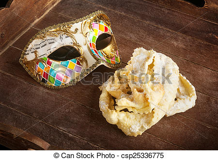 Picture of Fried pastry of italian carnival with venetian mask.