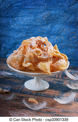 Stock Photos of traditional in Poland deep fried pastry faworki.