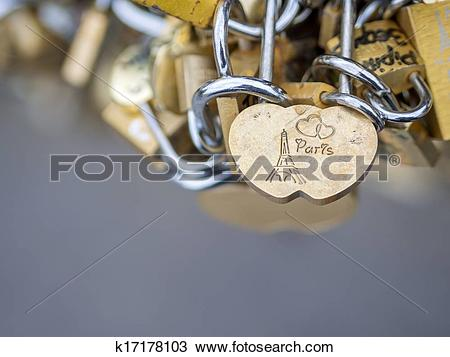 Stock Photo of Love locks in Paris bridge symbol of friendship and.