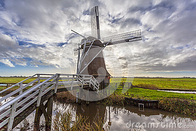 Frisian Farm And Wind Water Mill Stock Photo.