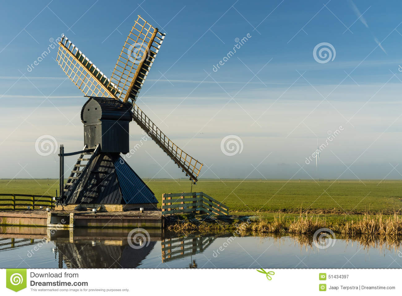Wooden Windmill At Frisian Landscape Stock Photo.