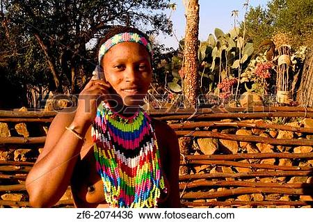 Stock Images of Colorful Woman with Cell Phone in Native Zulu.