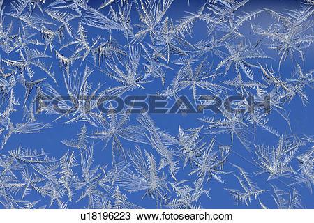 Stock Photo of Frost patterns on a window u18196223.