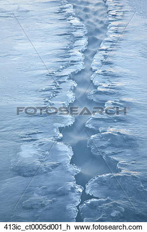 Stock Photo of Patrially frozen water channel on the Knik River.