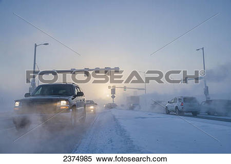 Stock Image of Traffic and ice fog in downtown Fairbanks, Alaska.