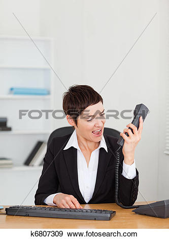 Stock Photograph of Angry secretary calling k6807309.