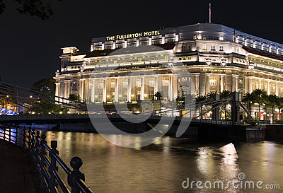 Fullerton Hotel In Singapore At Night Editorial Photography.