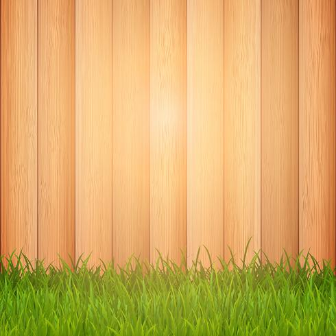 Grass on wooden background.