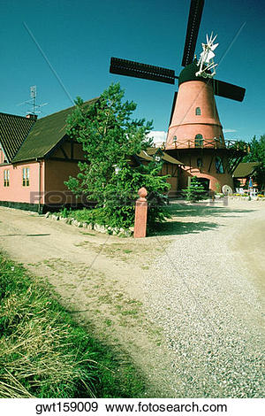 Stock Photograph of Windmill and a restaurant on a country road.