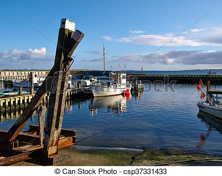 Stock Photos of Small fishing boats in a harbour at Funen Denmark.