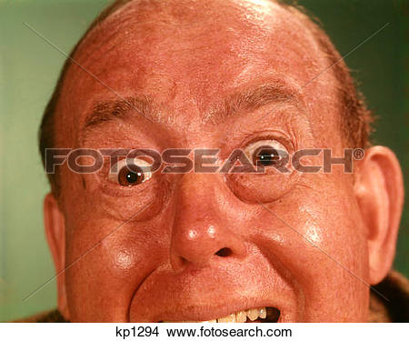 Stock Photo of 1960S Portrait Man Forehead To Chin Silly Wacky.