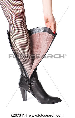 Stock Photo of Leather boot with fur on woman leg k2673414.